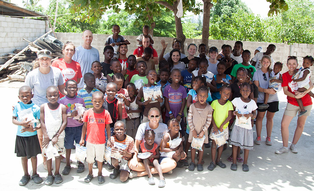 A group photo of New Life Staff with the children they are helping
