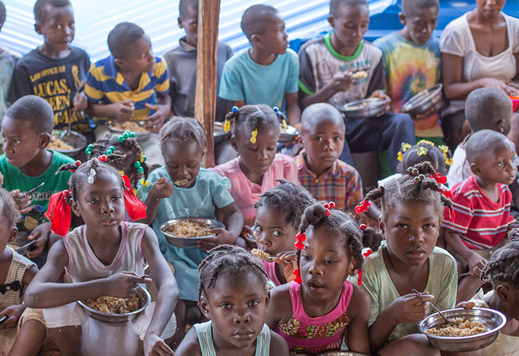 A group of children eating
